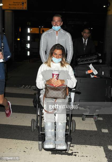 Katie Price and Carl Woods are seen returning to England from their holiday in the Maldives on November 6, 2020 in London, England.