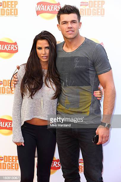 Katie Price and Leandro Penna attend the launch of Walkers Deep Ridged crisp at The Old Truman Brewery on August 29 2012 in London England