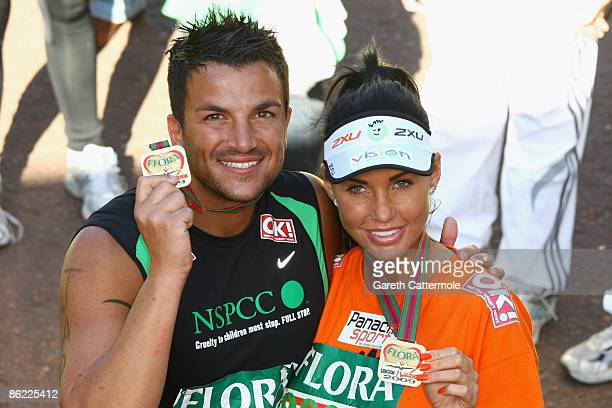 Katie Price and Peter Andre pose after they completed the 2009 Flora London Marathon on April 26, 2009 in London, England.
