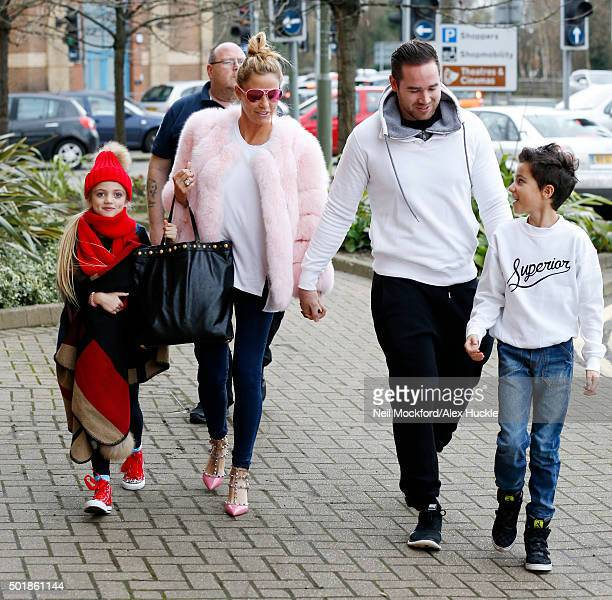 Katie Price arrives at the New Victoria Theatre with daughter Princess husband Kieran Hayler and son Junior Andre on December 18 2015 in Woking...