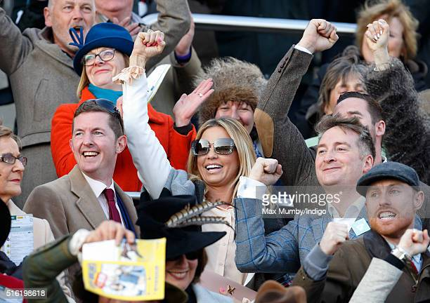 Katie Price cheers as she watches the racing on day 3 St Patrick's Day of the Cheltenham Festival on March 17 2016 in Cheltenham England