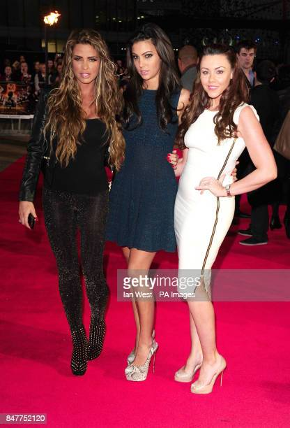 Katie Price Ellie Jenas and Michelle Heaton arrive at the premiere of The Hunger Games at the O2 in London
