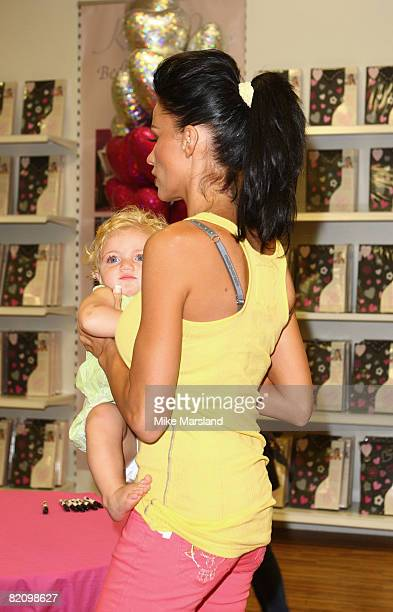 Katie Price holds Princess Tiaami during the launch of her bed linen range at Matalan on July 29 2008 in Milton Keynes England