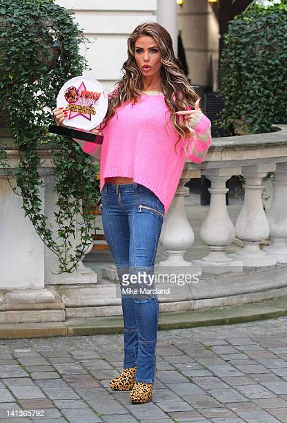 Katie Price is awarded Foxy Bingo Celebrity Mum Of The Year 2012 at Renaissance Chancery Court Hotel on March 15 2012 in London England