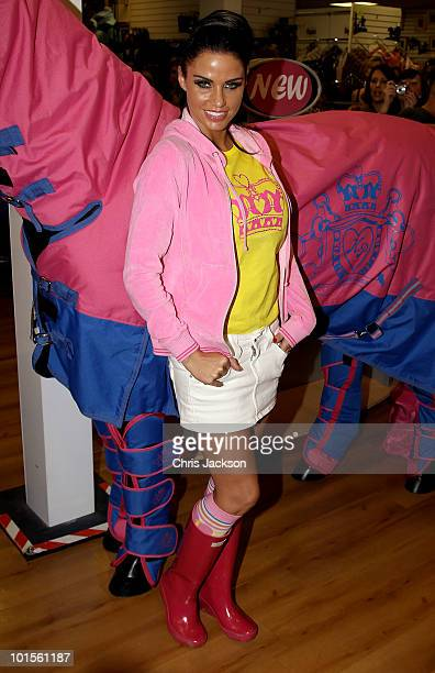 Katie Price poses for a photograph at a Katie Price Equestrian Range product signing at Ingatestone Saddlery on June 2 2010 in Ingatestone England