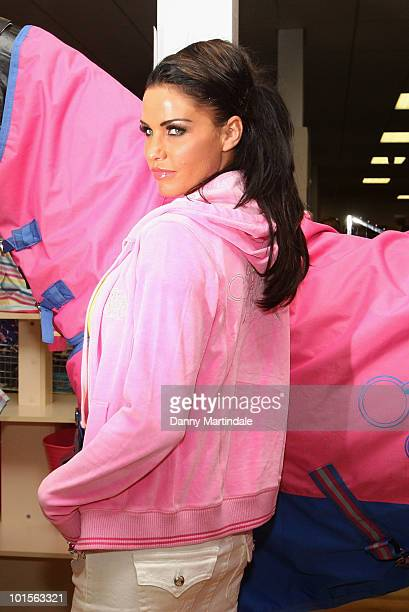 Katie Price poses for a photograph at a Katie Price Equestrian Range product signing for her KP Equestrian range on June 2 2010 in Chelmsford England