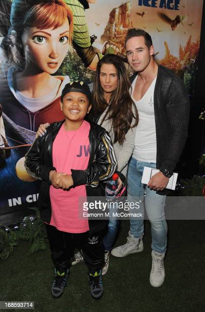 Katie Price with her son Harvey and husband Kieran Hayler attend the Gala Screening of 'Epic' at Vue West End on May 12 2013 in London England