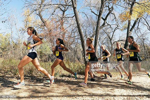 Katie Rainsberger of Air Academy leads Kayla Young of Denver North Greta VanCalcar of Palisade Lauren Offerman of Mountain View Riley Cooney of...