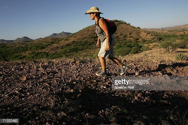 Katie Resendiz a volunteer on patrol with the humanitarian group No More Deaths searches for potential migrants in distress on a trail used by those...