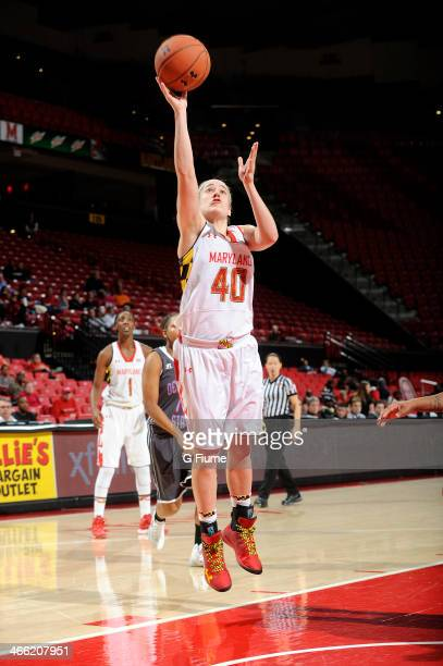 Katie Rutan of the Maryland Terrapins drives to the hoop against the Delaware State Hornets at the Comcast Center on December 14 2013 in College Park...