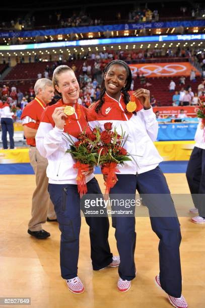 Katie Smith and DeLisha Milton-Jones of the U.S. Women's Senior National Team celebrate after winning the gold medal against Australia at the Beijing...