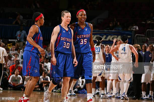 Katie Smith Cheryl Ford and Deanna Nolan of the Detroit Shock walk to the bench against the New York Liberty during the game on July 12 2008 at...
