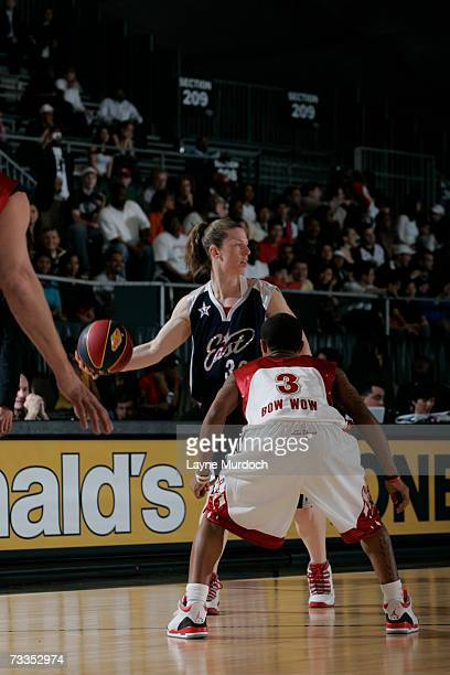 Katie Smith of the Detroit Shock dribbles against hip hop artist Bow Wow during the McDonald's NBA AllStar Celebrity Game Presented by 2K Sports at...