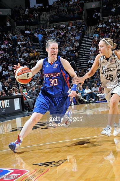 Katie Smith of the Detroit Shock drives against Becky Hammon of the San Antonio Silver Stars during Game Two of the WNBA Finals on October 3 2008 at...