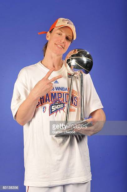 Katie Smith of the Detroit Shock poses for a portrait with the Championship Trophy after winning Game Three of the WNBA Finals against the San...