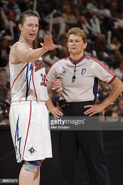 Katie Smith of the Detroit Shock talks with referee June Courteau during the game against the Los Angeles Sparks on June 8, 2009 at The Palace of...