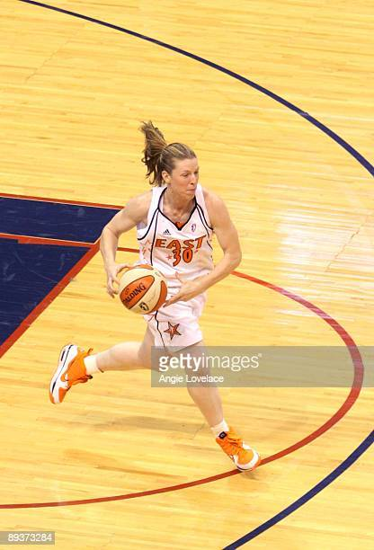 Katie Smith of the Eastern Conference transitions the ball down the court against the Western Conference during the 2009 WNBA AllStar Game on July 25...