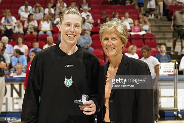 Katie Smith of the Minnesota Lynx accepts a ring honoring her assistance in the 2002 World Championships from USA Basketball assistant executive...