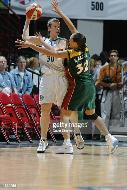 Katie Smith of the Minnesota Lynx is defended by Adia Barnes of the Seattle Storm during the game on August 4 2002 at Target Center in Minneapolis...