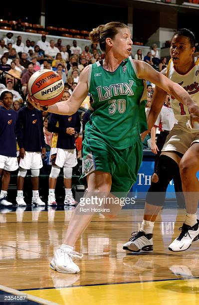Katie Smith of the Minnesota Lynx looks to pass during the game against the Indiana Fever at Conseco Fieldhouse on July 26 2003 in Indianapolis...