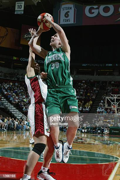 Katie Smith of the Minnesota Lynx shoots over Adia Barnes#32 of the Seattle Storm on July 31 2002 at Key Arena in Seattle Washington The Storm won...