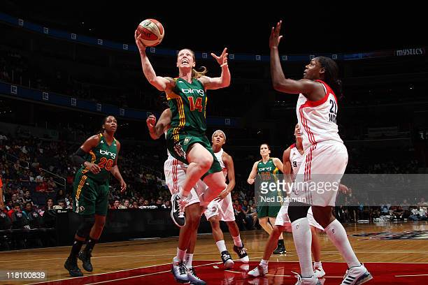 Katie Smith of the Washington Mystics drives against Nicky Anosike of the Seattle Storm at the Verizon Center on July 3 2011 in Washington DC NOTE TO...
