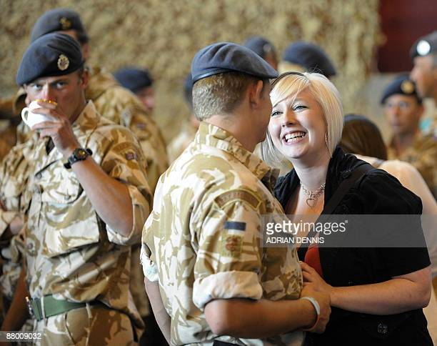 Katie Stannard greets her boyfriend Senior Aircraftsman Sean Thompson as personnel of 15 Squadron Royal Air Force Regiment return to RAF Honington...