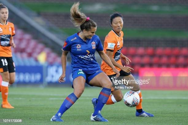 Katie Stengel of Newcastle Jets contests the ball against Yuki Nagasato of Brisbane Roar during the round five WLeague match between the Newcastle...