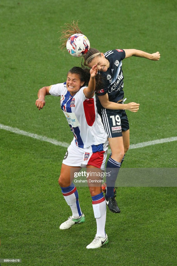 Katie Stengel of the Jets (L) and Kristen McNabb of the Victory compete in the air during the round nine W-League match between the Melbourne Victory and the Newcastle Jets at AAMI Park on December 29, 2017 in Melbourne, Australia.