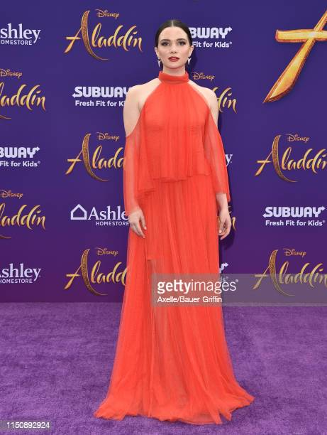 Katie Stevens attends the premiere of Disney's Aladdin on May 21 2019 in Los Angeles California