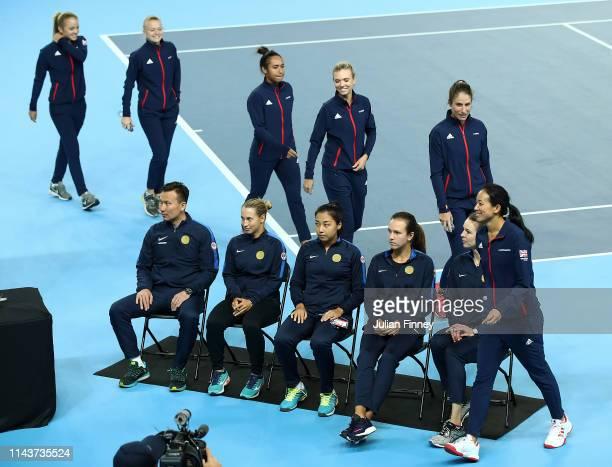 Katie Swan, Harriet Dart, Heather Watson, Katie Boulter, Johanna Konta, Anne Keothavong arrive for the draw along side Kazakhstan's Dias Doskarayev,...