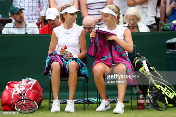 Katie Swan of Great Britain and Katie Boulter of Great Britain speak during the Ladies Doubles first round match against Timea Babos of Hungary and...