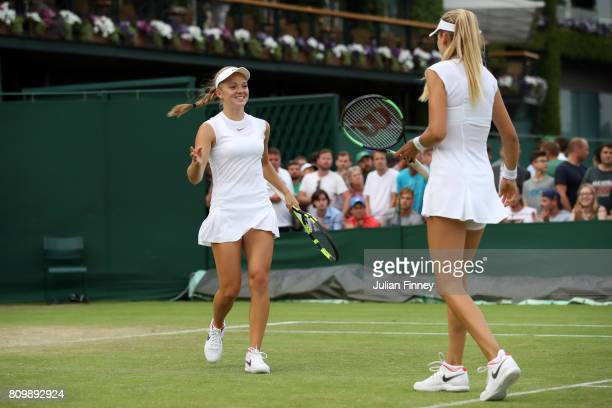 Katie Swan of Great Britain and Katie Boulter of Great Britain celebrate during the Ladies Doubles first round match against Timea Babos of Hungary...