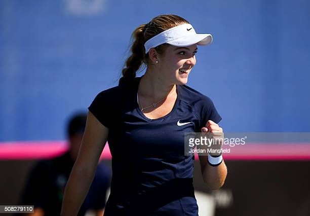 Katie Swan of Great Britain celebrates winning her match against Ilze Hattingh of South Africa during the tie between South Africa and Great Britain...