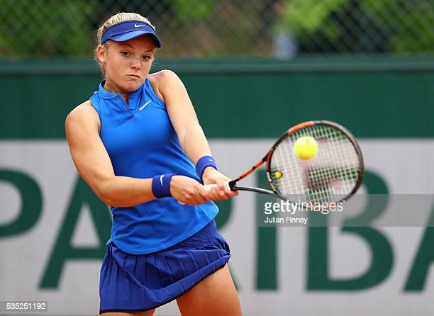 Katie Swan of Great Britain hits a backhand during the Girls Singles first round match against Caty McNally of the United States on day eight of the...