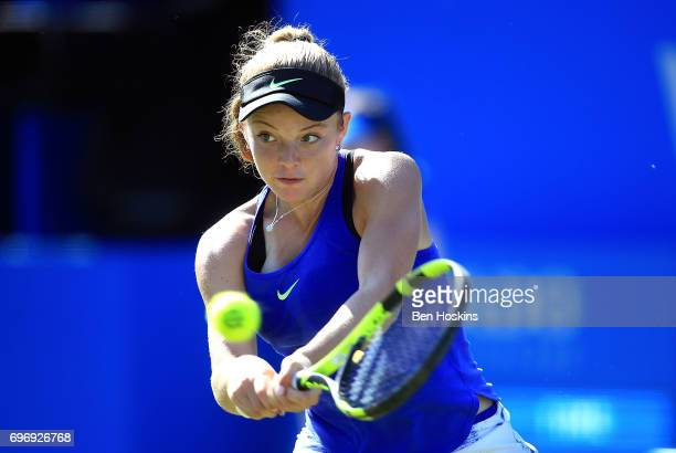 Katie Swan of Great Britain hits a backhand during the qualifying match against Elizaveta Kulichkova of Russia at Edgbaston Priory Club on June 17...