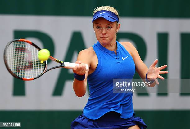 Katie Swan of Great Britain hits a forehand during the Girls Singles first round match against Caty McNally of the United States on day eight of the...