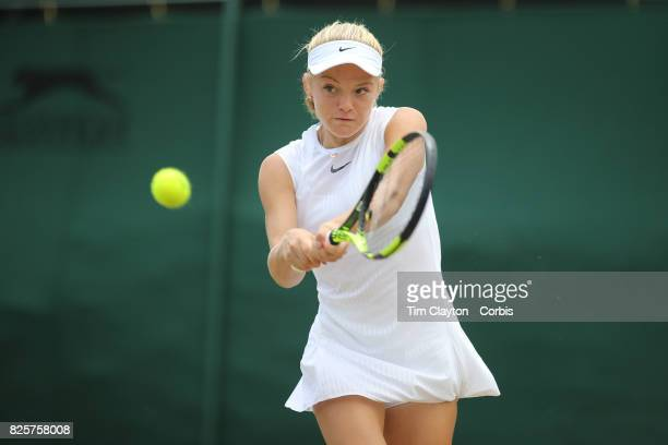 Katie Swan of Great Britain in action against Whitney Osuigwe of the United States in the Girls' Singles Tournament during the Wimbledon Lawn Tennis...