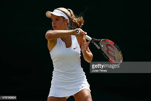 Katie Swan of Great Britain in action in the Girls Singles Second Round match against Deria Nur Haliza of Indonesia during day eight of the Wimbledon...