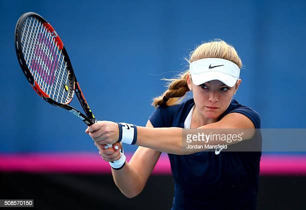 Katie Swan of Great Britain plays a backhand during her match against Ekaterine Gorgodze of Georgia during the tie between Georgia and Great Britain...