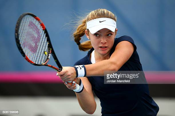 Katie Swan of Great Britain plays a backhand during her match against Ysaline Bonaventure during the tie between Belgium and Great Britain on day...