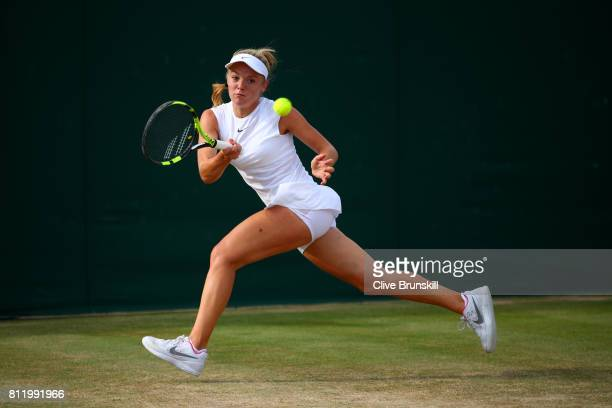 Katie Swan of Great Britain plays a backhand during the Girl's Singles first round match against Lara Schmidt of Germany on day seven of the...