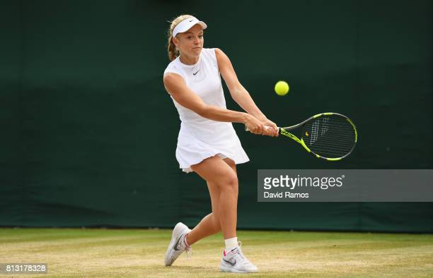 Katie Swan of Great Britain plays a backhand during the Girl's Singles third round match against Whitney Osuigwe of the United States on day nine of...