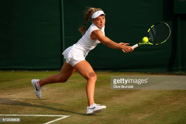 Katie Swan of Great Britain plays a backhand during the Mixed Doubles first round match against Mikhail Elgin of Russia and Anastasia Rodionova of...