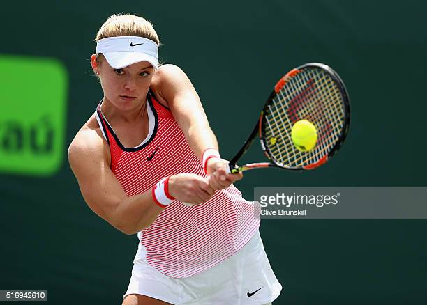 Katie Swan of Great Britain plays a backhand in her final qualifying round match against Samantha Crawford of the USA during the Miami Open Presented...