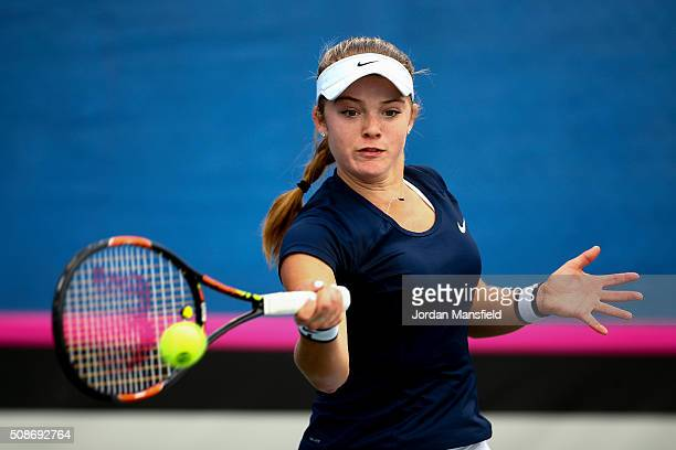 Katie Swan of Great Britain plays a forehand during her match against Ysaline Bonaventure during the tie between Belgium and Great Britain on day...