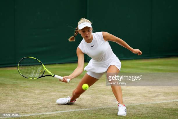 Katie Swan of Great Britain plays a forehand during the Ladies Doubles first round match with Katie Boulter of Great Britain against Timea Babos of...