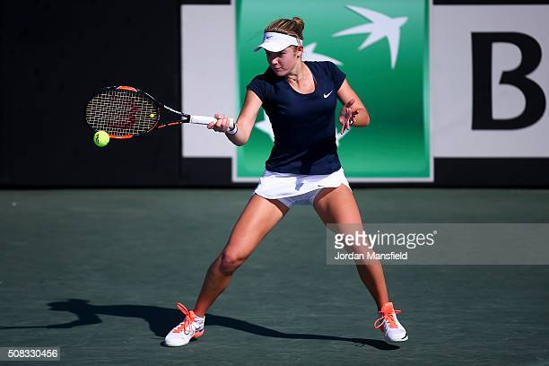 Katie Swan of Great Britain plays a forehand in her match against Ilze Hattingh of South Africa during the tie between South Africa and Great Britain...