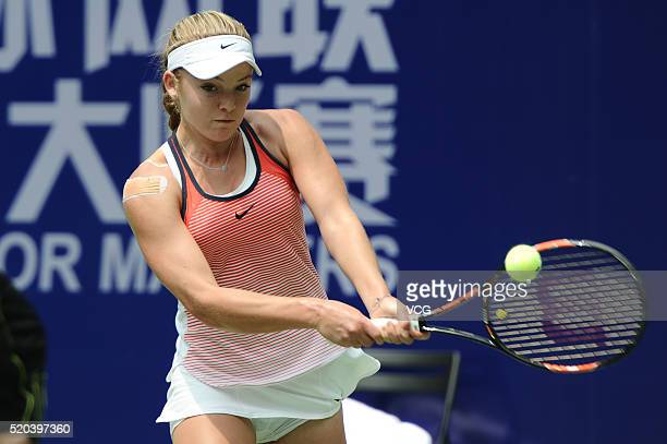 Katie Swan of Great Britain returns a shot in her Women's Singles Final match against Anna Blinkova of Russia during the 2016 ITF Junior Masters at...