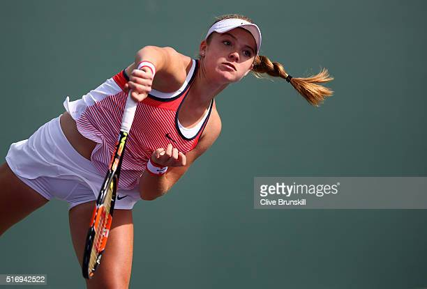 Katie Swan of Great Britain serves in her final qualifying round match against Samantha Crawford of the USA during the Miami Open Presented by Itau...